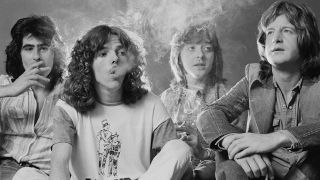 A photograph of Badfinger smoking cigarettes, taken in 1973