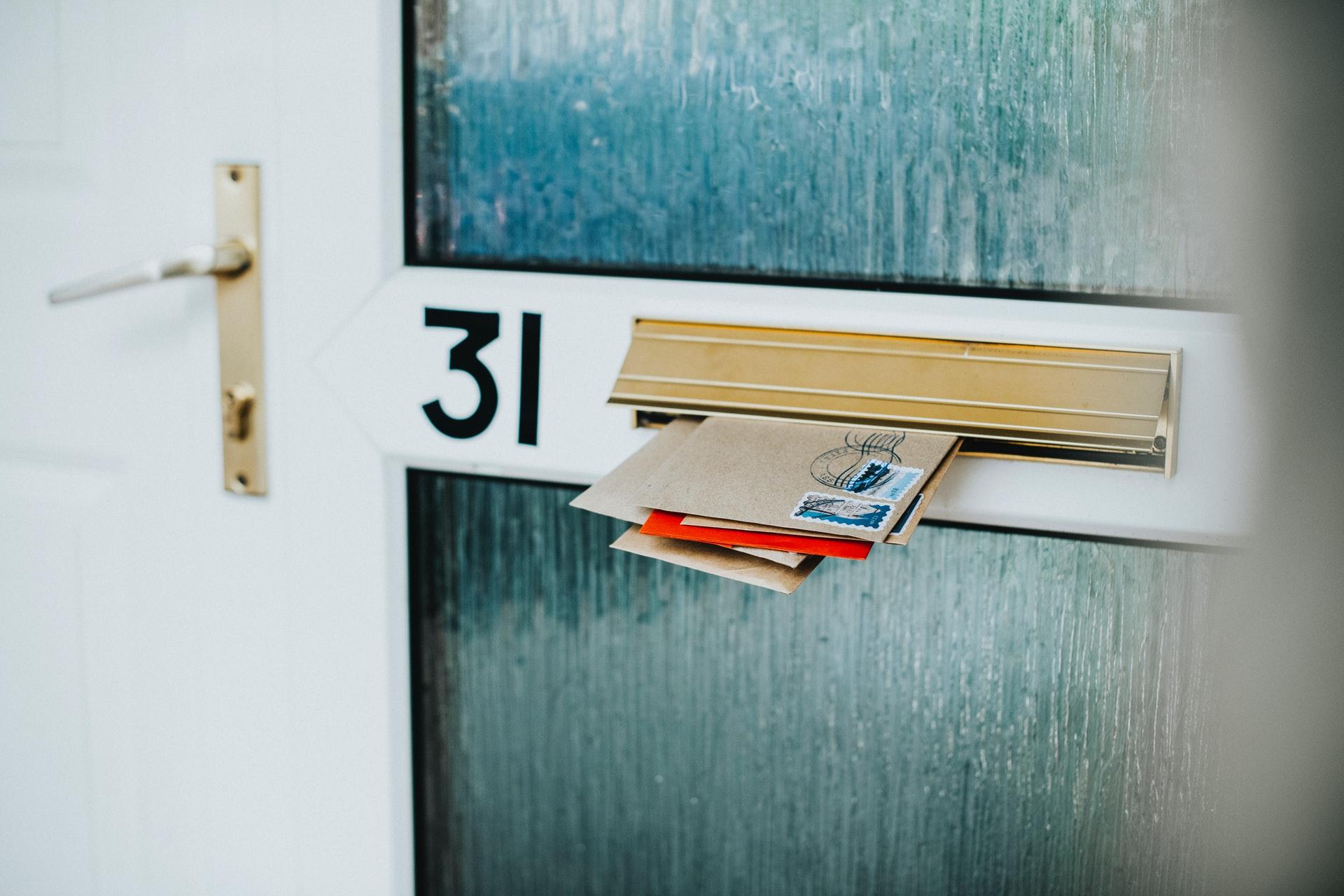 Envelopes stuffed into a mailbox