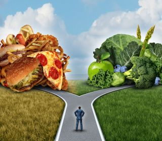 An artist's image shows a person trying to decide whether to eat healthy food or tastier junk food.