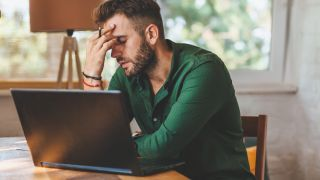 Man having Windows 11 problems with his laptop