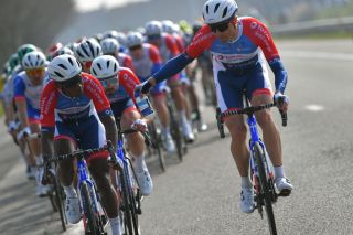 DE PANNE BELGIUM MARCH 24 Lorrenzo Manzin of France Edvald Boasson Hagen of Norway and Team Total Direct Energie during the 45th Oxyclean Brugge De Panne 2021 Men Classic a 2039km race from Brugge to De Panne Feeding Bottle OxycleanClassic on March 24 2021 in De Panne Belgium Photo by Luc ClaessenGetty Images