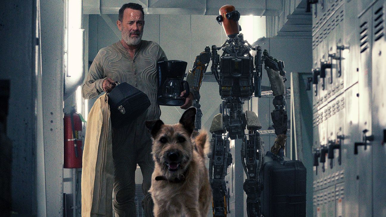 A shot of Tom Hanks with his robot in the movie Finch