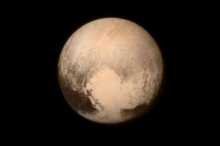 New Horizons' photo of Pluto showing the heart-shaped area now informally named Tombaugh Regio