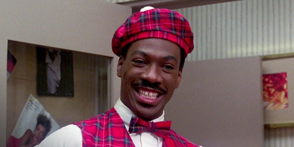 Eddie Murphy as Akeem in his McDowell's uniform in Coming to America