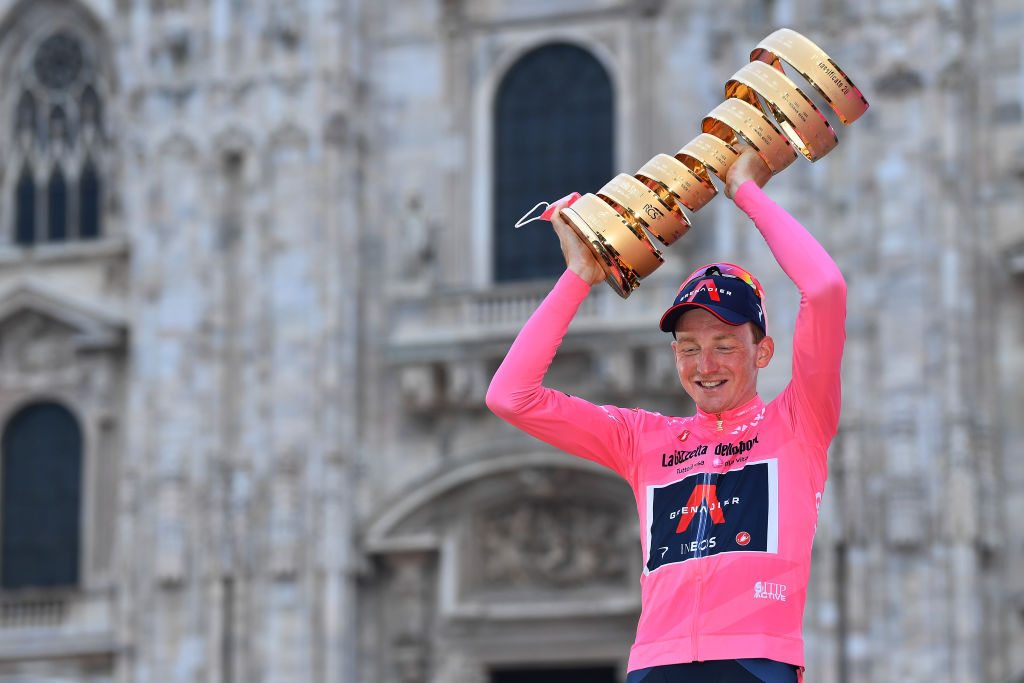 MILANO ITALY OCTOBER 25 Podium Tao Geoghegan Hart of The United Kingdom and Team INEOS Grenadiers Pink Leader Jersey Celebration Trophy Duomo di Milano Milan Cathedral during the 103rd Giro dItalia 2020 Stage 21 a 157km Individual time trial from Cernusco sul Naviglio to Milano ITT girodiitalia Giro on October 25 2020 in Milano Italy Photo by Stuart FranklinGetty Images