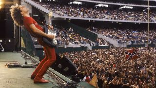 A photograph of Sammy Hagar on stage at Oakland Stadium in 1979