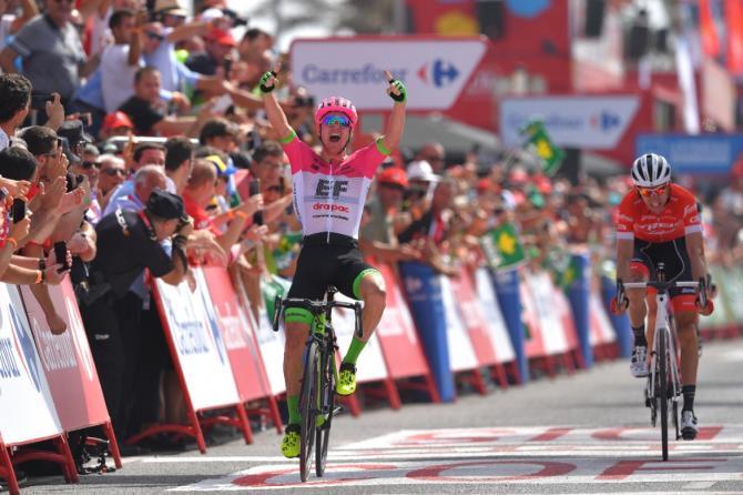 Simon Clarke raises his arms in celebration