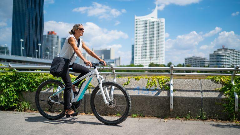 Woman cycling e bike in the city