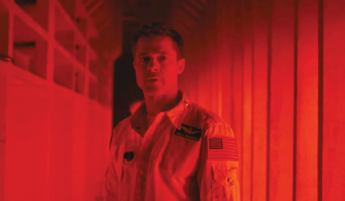 Ad Astra Brad Pitt bathed in red light
