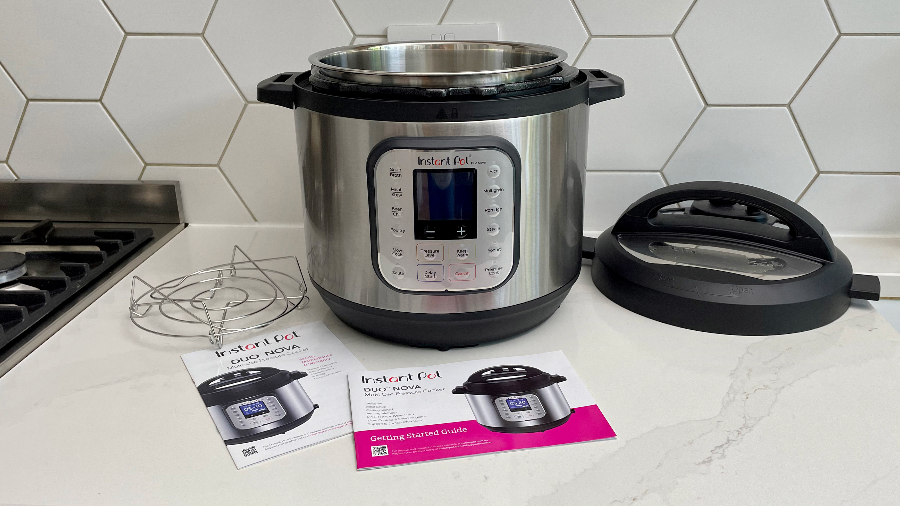 The Instant Pot Duo Nova on a kitchen countertop surrounded by its accessories