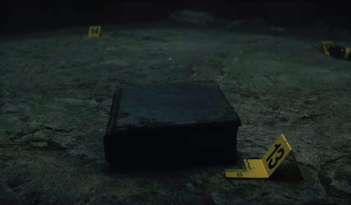 The spell book ominously sits at the crime scene in Fear Street: Part 3 - 1666.