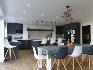 a modern kitchen design with charcoal grey cabinets