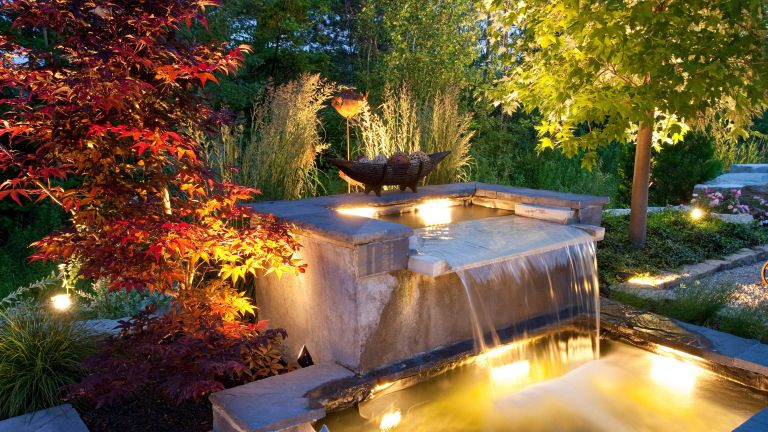 pond ideas with waterfalls: waterfall with lighting in garden