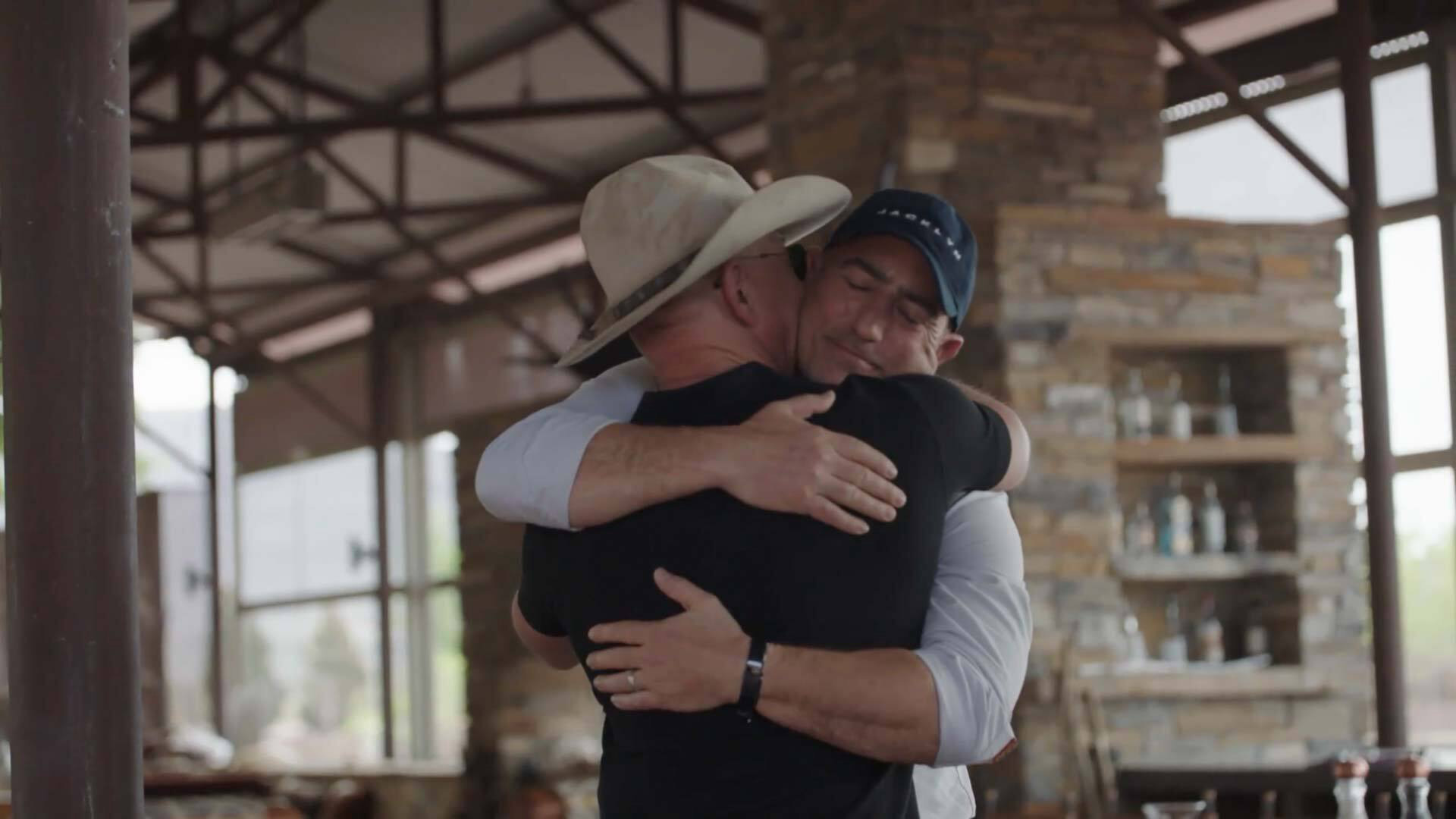 Mark Bezos hugs his brother Jeff. The two will launch to space together on a Blue Origin New Shepard on July 20, 2021.
