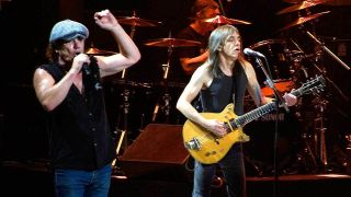 Brian Johnson & Malcolm Young onstage in 2008