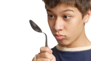 boy bends spoon with mind