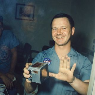 NASA photographer Terry Slezak shows off the moon dust on his fingers.