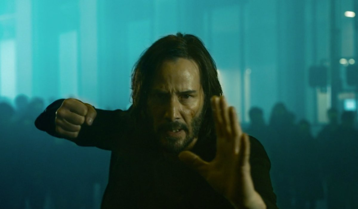 Neo readies his fists for a fight in The Matrix Resurrections.