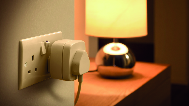 Smart plug next to lamp