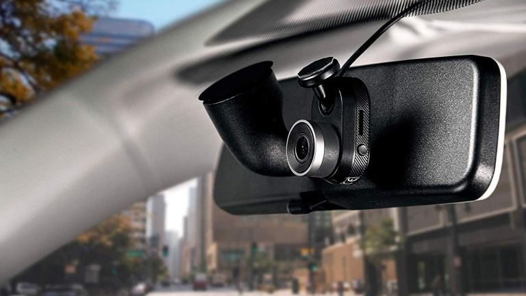 The Garmin Dash Cam Mini, one of the best front and rear dash cam combos, on a car windscreen