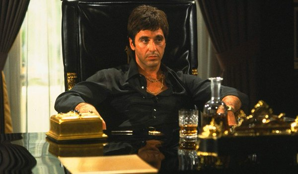 Scarface Al Pacino sits laid back in his office