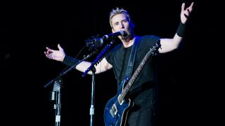 Chad Kroeger of Nickelback performs on stage during a concert in the Rock in Rio Festival on September 20, 2013 in Rio de Janeiro, Brazil