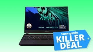 Gigabyte Aero 15 gaming laptop on a green background