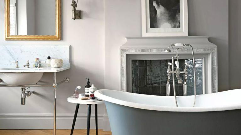 Grey bathroom idea with freestanding bath tub and pale grey walls
