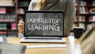 """Laptop computer displays """"Never Stop Learning"""""""