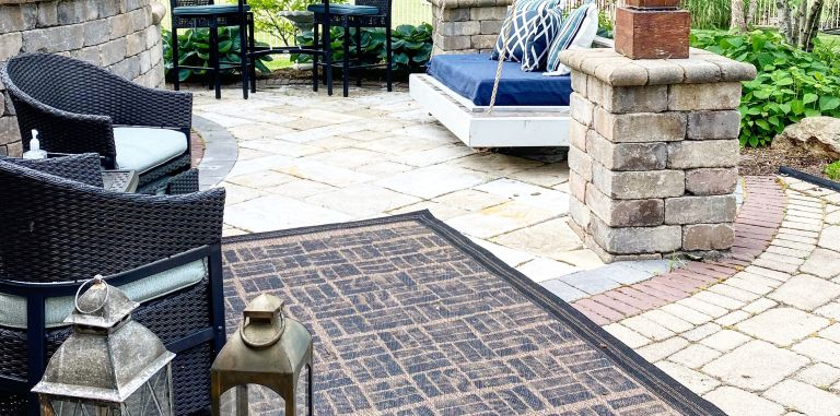 a painted outdoor rug on a patio