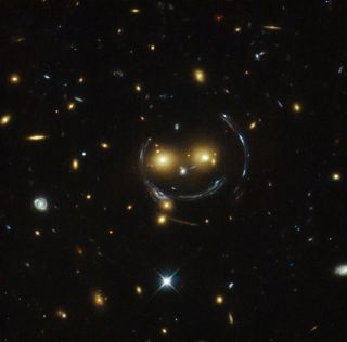 Smiling Face of Galaxy Cluster SDSS J1038+4849