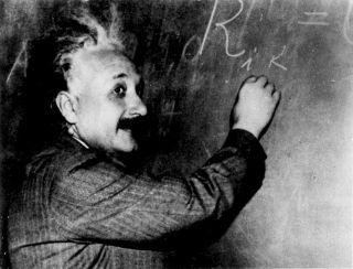 Famed physicist Albert Einstein at the blackboard.