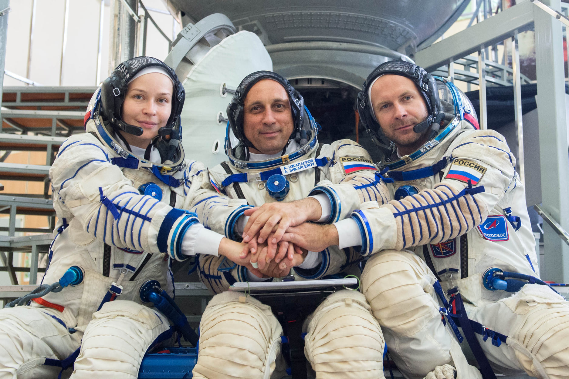 Actor Yulia Peresild (left), cosmonaut Anton Shkaplerov (center) and director Klim Shipenko (right) are scheduled to launch toward the International Space Station on Oct. 5, 2021.