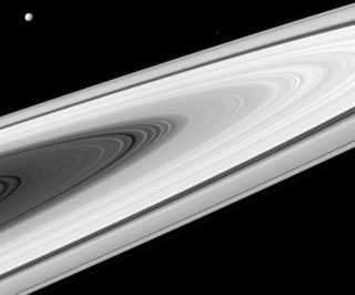 Saturn's rings and two of its moons, Dione and Epimetheus, can be seen in this image taken with the Cassini spacecraft wide-angle camera on April 2, 2016.