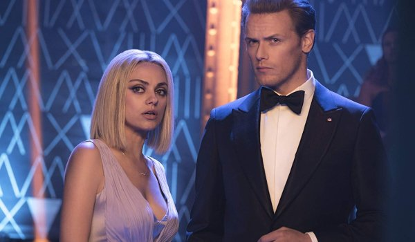 The Spy Who Dumped Me Mila Kunis in disguise with Sam Heughan in a tux