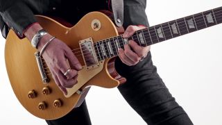 Man playing Les Paul electric guitar
