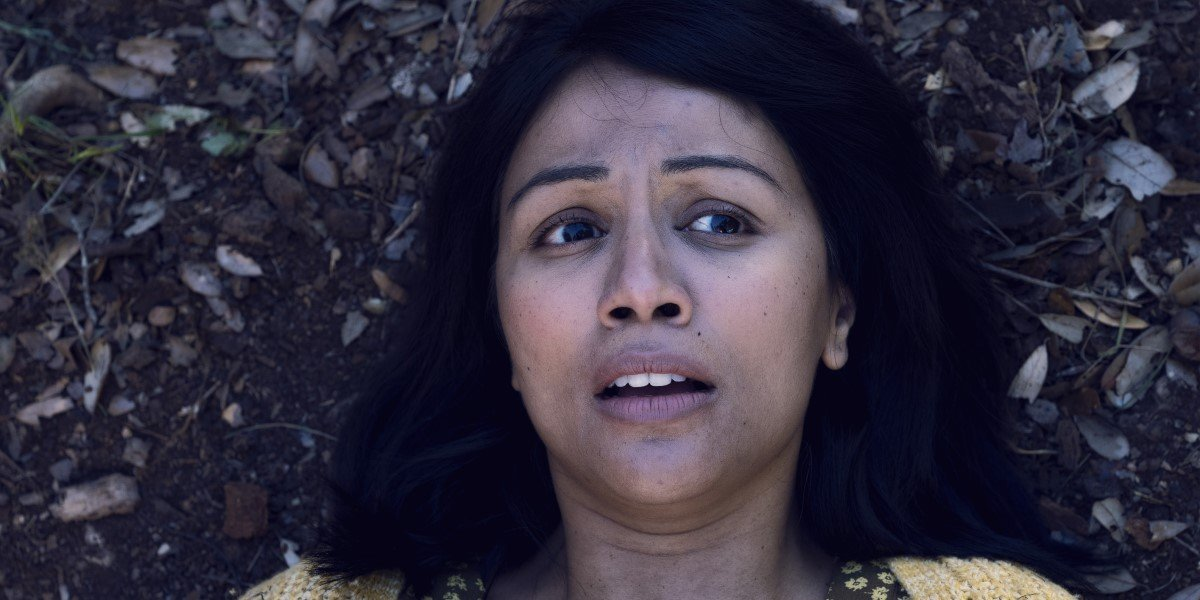 karen david's grace laying in the leaves on fear the walking dead