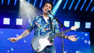 John Mayer performs live with a PRS Silver Sky electric guitar