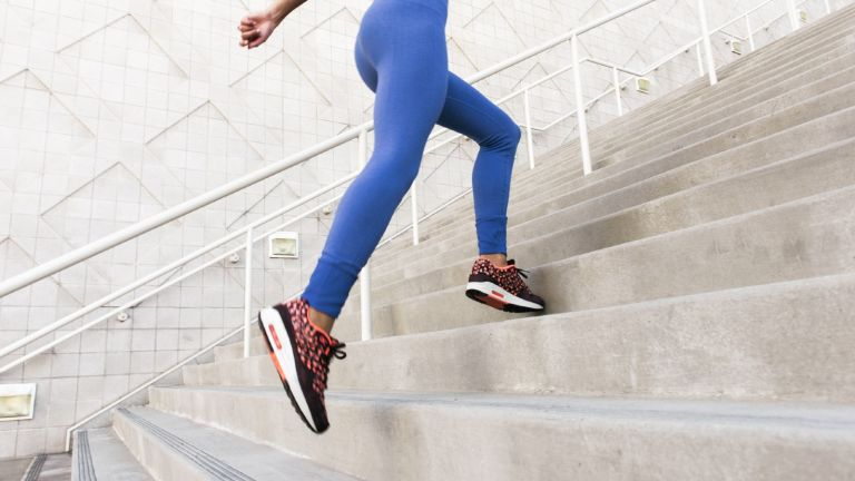 best workout leggings: woman running up stairs