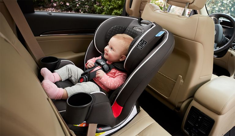 Walmart car seat trade in 2019: child in carseat in car