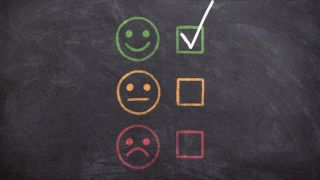 An image of three face icons, showing happy, sad, and inbetween, to signify customer reviews and satisfaction with a service