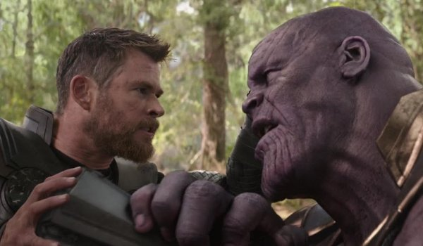 Avengers: Infinity War Thor pushes the ax into Thanos at Wakanda