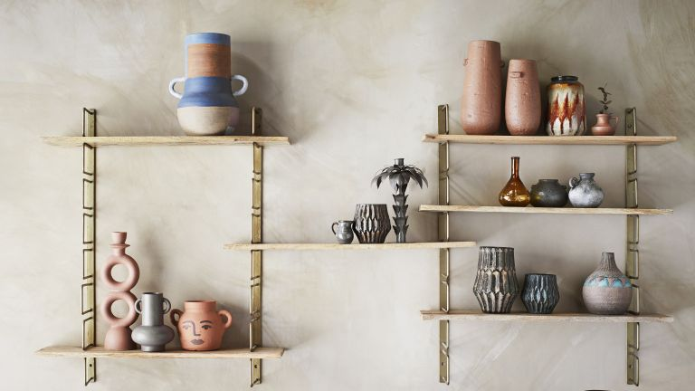 Terracotta vases, floral vases on a shelf, colorful vases for flowers