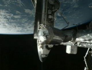 The space shuttle Endeavour docked to the International Space Station for its final visit Wednesday (May 18).