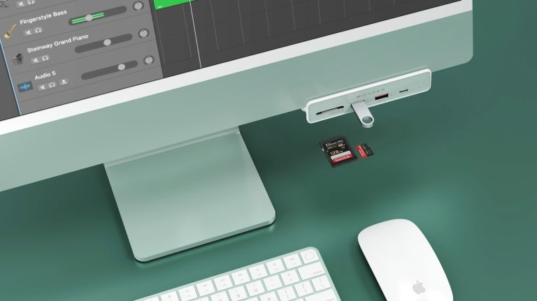 Hyper 6 in 1 USB hub in green attached to green iMac