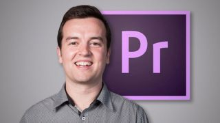 A man smiling in front of the Adobe Premiere Pro CC logo