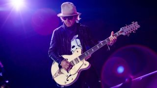 Tom Petersson member of the band Cheap Trick performs live on stage at Allianz Parque on December 13, 2017 in Sao Paulo, Brazil