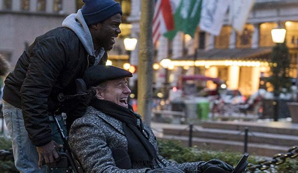 The Upside Kevin Hart and Bryan Cranston joy riding on a wheelchair in the city