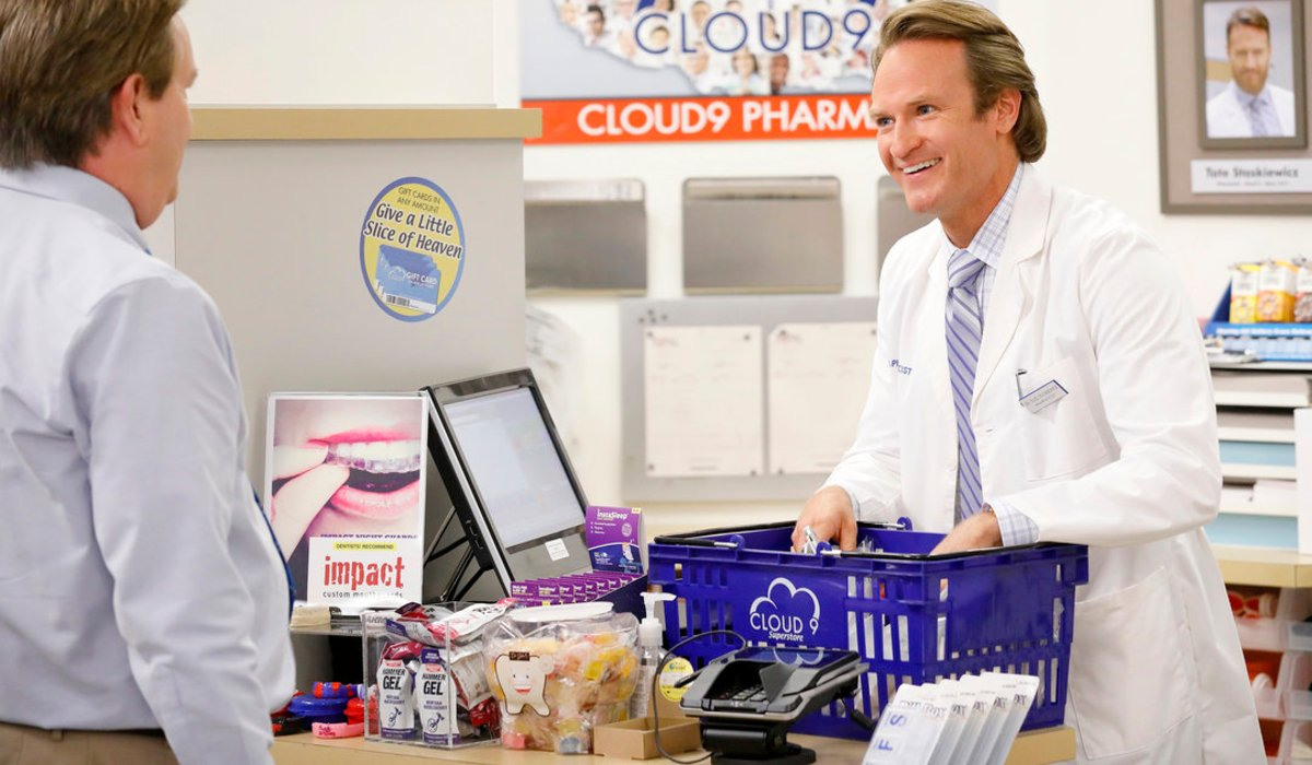 Superstore Tate talks to Glenn as he sorts a shopping basket
