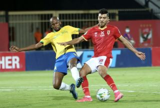 Mohamed Sherif of Al Ahly challenged by Mosa Lebusa of Mamelodi Sundowns